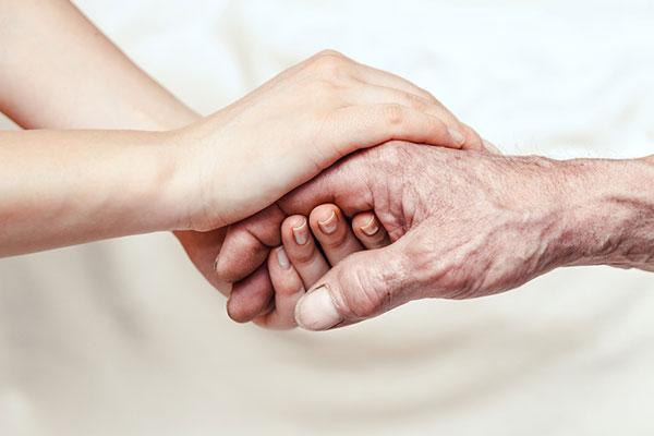 Child holding elder's hand